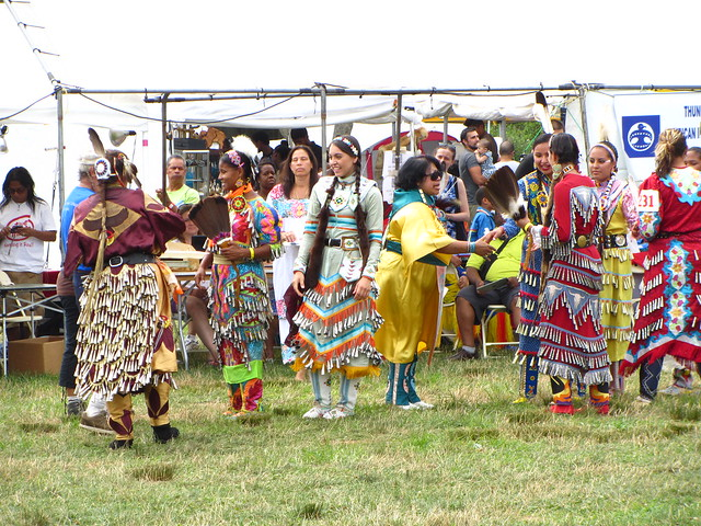 jingle dress dancers greet one another