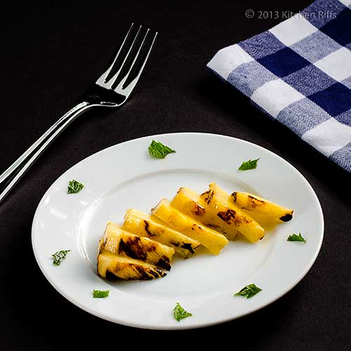 Grilled Pineapple slices on plate with mint garnish