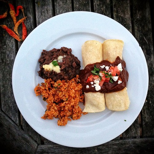 Mexican night at the OC #airbnb: butternut squash & feta mole enchiladas, refried black beans, Mexican rice.