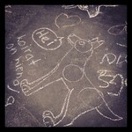 """Doggies are nice"" - chalk drawings at #sarjakuvafestivaalit"