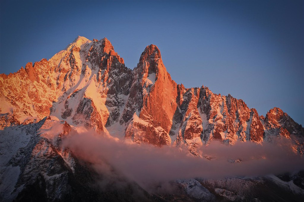 Alpenglow on Aguille Verte (4122m) and Les Drus (3754m). Massif du Mont Blanc. Haute-Savoie. France.