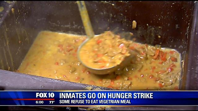 a photo of news coverage of the hunger strike, which says the inmates are refusing vegetarian food