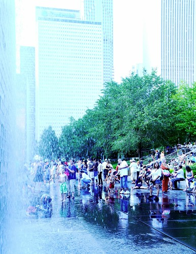 Waterfall Fountains at Millenium Park, reflections, waterfall, families and kids playing, shallow pool, hot bright day, skyscrapers, sheltering trees, Chicago, Illinois, USA by Wonderlane