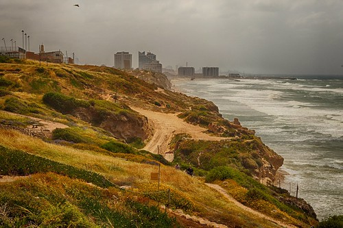 beacheslandscapes sea shore beach landscape waves storm herzliya israel mediterranean middle east building bird windy