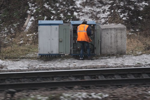 Railway worker inspecting a signalling equipment cabinet