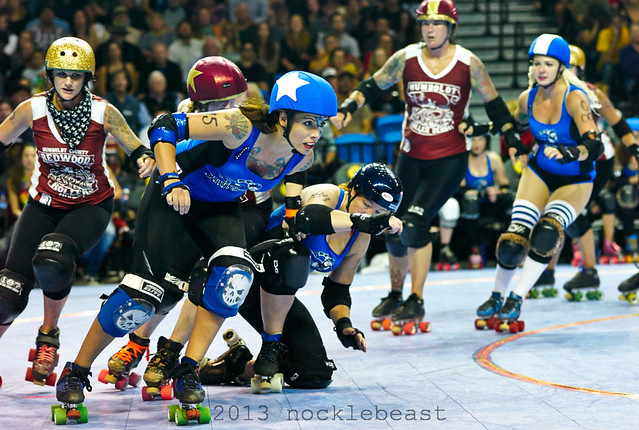 Pippi Hardsocking #45 breaks out of the pack wearing skull kneepads