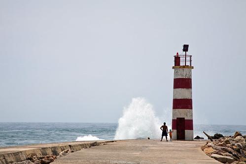 ocean travel sea vacation people lighthouse holiday beach portugal landscape faro pier wave landmark safety destination isladeserta warnimng dermotdoorlylifestyle