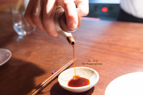 Pouring ginger infused soy sauce