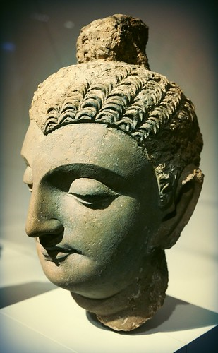 Lord Buddha's head, stylicized Mediterranean curly hair and topknot (ushnisha), knocked off the body of a statue, stone, gandharvan, Greek influenced design, Chicago Art Institute, Chicago, Illinois, USA by Wonderlane