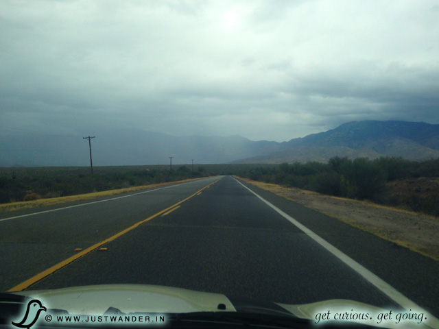 PIC: We're in our Mini Cooper driving on E Colossal Cave Rd heading to Colossal Cave Mountain Park for some spelunking.
