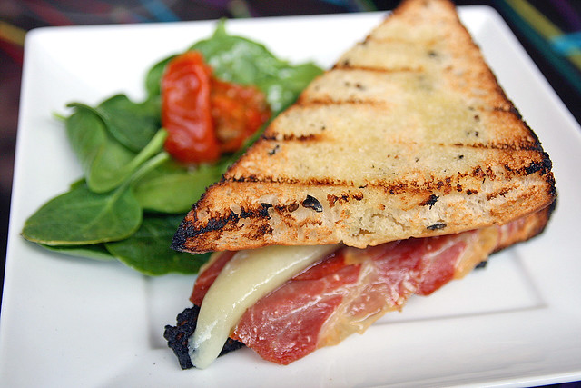 Grilled Olive Bread stuffed with Manchego Cheese and Serrano Ham
