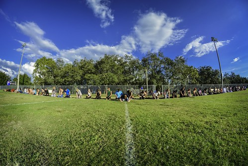 park blue people green sports field contrast landscape group ceremony fisheye silence moment veteransmemorialpark wots