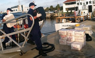 Coast Guard crewmembers offload 24 bales of cocaine at Coast Guard Sector St. Petersburg, Fla., Wednesday, Dec. 4, 2013. The crew of the Coast Guard Cutter Gallatin, a 378-foot high endurance cutter homported in Charleston, S.C., and their deployed MH-65 Dolphin Helicopter crew seized more than $18 million in cocaine in the Gulf of Mexico during two separate cases in November in support of Operation Martillo. U.S. Coast Guard photo by Petty Officer 2nd Class Michael De Nyse