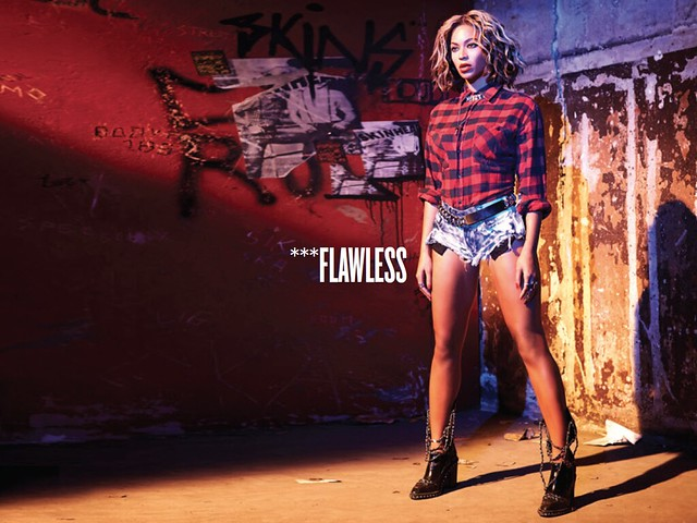"Beyonce wearing cutoff shorts in an industrial landscape for her song ""flawless"""