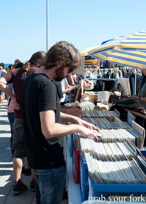Browsing records at the Lost & Found Fashion Market on Barceloneta Beach, Barcelona