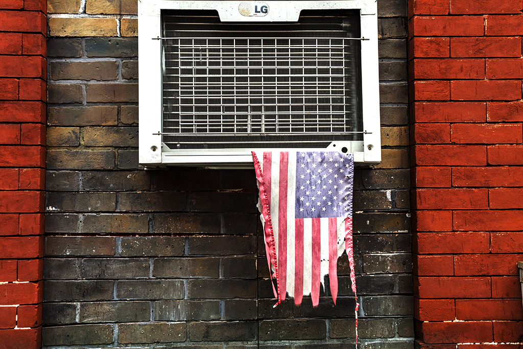 Torn-flag-hanging-from-air-conditioner--Hoboken