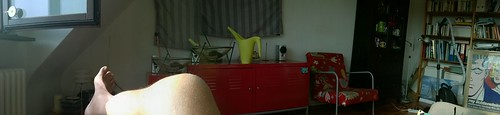 Living room panorama with nackend leg
