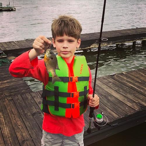 Eli nabbing his first fish.