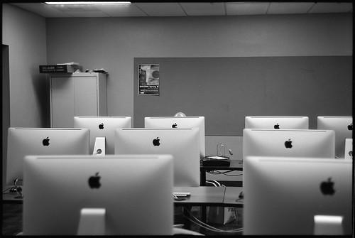 Budd's shiny head hiding behind a Mac.