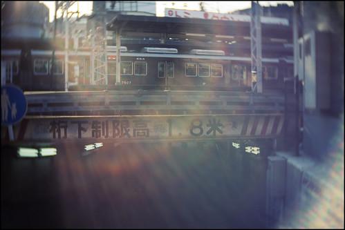 city light sunset urban blur station japan train lensflare 日本 osaka kansai eki hankyu juso 大阪市 osakashi 十三 関西地方 十三駅 jusostation 淀川区 yodogawaku olympusem5 slrmagic26mmf14toylens jusoeki