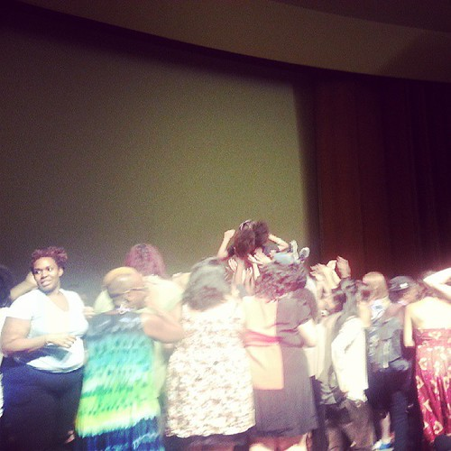Beautiful crowd surfing at the opening ceremony at #amc2013 #detroit. People of all ages were crowd surfing on stage!