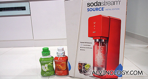SodaStream Source and two bottles of syrup