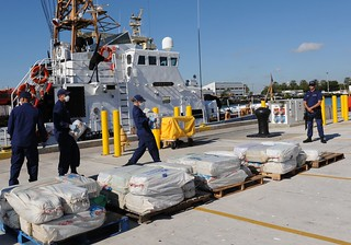 Crewmembers aboard the Coast Guard Cutter Sitkinak, homeported in Miami Beach, Fla., offload 2,500 pounds of cocaine worth an estimated $37 million wholesale value, Tuesday January 28, 2014 at Coast Guard Base Miami Beach. The contraband was seized in a multi-national counterdrug operation south of the Dominican Republic and is the first time an armed U.S. Coast Guard helicopter embarked on a foreign flagged military vessel in support of counterdrug operations. U.S. Coast Guard photo by Petty Officer 1st Class Crystalynn A. Kneen.