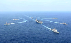 Ships of the Carl Vinson Carrier Strike Group and JMSDF steam in formation, March 28. (JMSDF photo)
