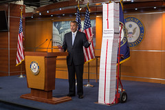 "Speaker John Boehner holds a press conference with the ""Red Tape Tower"" of ObamaCare regulations. May 16, 2013. (Official Photo by Bryant Avondoglio)  --- This official Speaker of the House photograph is being made available only for publication by news organizations and/or for personal use printing by the subject(s) of the photograph. The photograph may not be manipulated in any way and may not be used in commercial or political materials, advertisements, emails, products, promotions that in any way suggests approval or endorsement of the Speaker of the House or any Member of Congress."