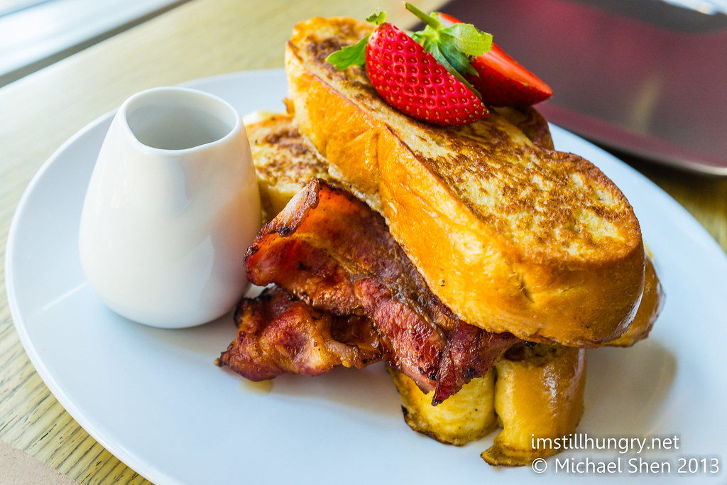 Brioche french toast w/caramelised banana, bacon & maple syrup chalkboard cafe
