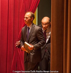 Alan Greenspan is escorted to the stage by Mark Zandi