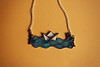Sailing paper boat necklace by Isa Bel.