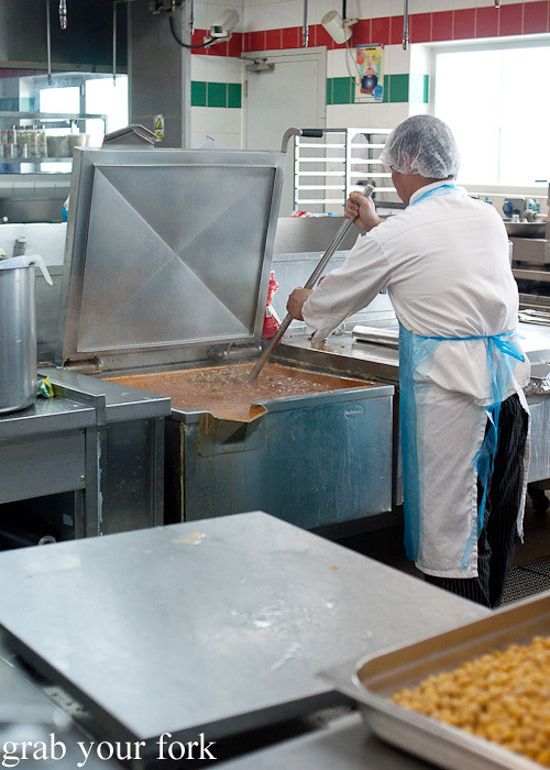 Preparing giant stew during a behind-the-scenes tour of Emirates Flight Catering