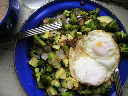 fried eggs with avocado broccoli onion hash