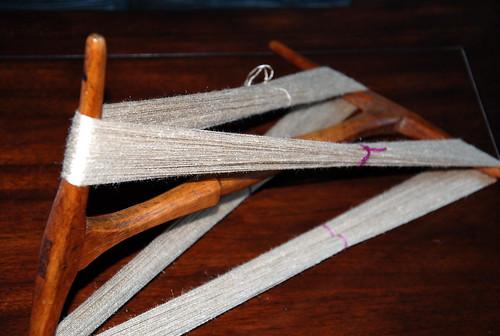 Muga silk handspun lace yarn on antique Canadian niddy noddy
