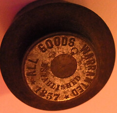 1857 All Goods Warranted die (reversed)