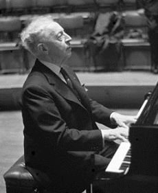 Arthur Rubinstein rehearsing at the piano in 1962