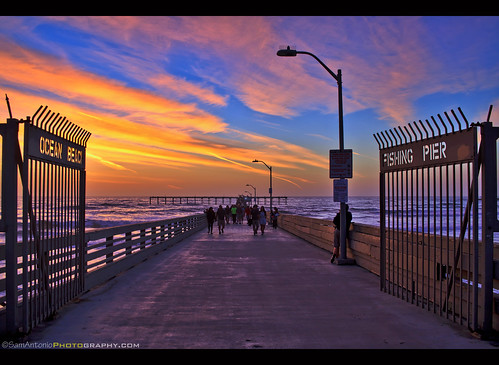 oceanbeach sunset pier nature sky sandiego beach orange colorful pacific landscape water travel california ocean architecture wharf sand sea serene scenic landmark night surf silhouettes shore view background blue beautiful clouds sunsetbeach southerncalifornia dusksky outdoors dusk evening waves america samantoniophotography gate entrance opening people vacation