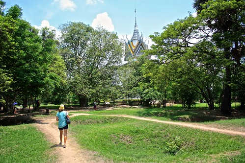 walking the grounds of the killing fields. the temple with all the exhumed bones in the distance