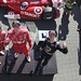 Scott Dixon, Sebastien Bourdais, and Dario Franchitti pose on the podium in Toronto after Race 1`