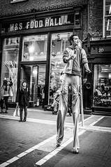 Street artist in Grafton Street, Dublin - Black and white photo
