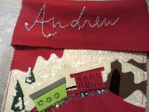 Vintage-style custom stocking, train and name detail