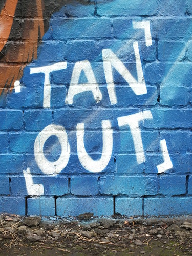 'tan out' street art version 2 by Squid