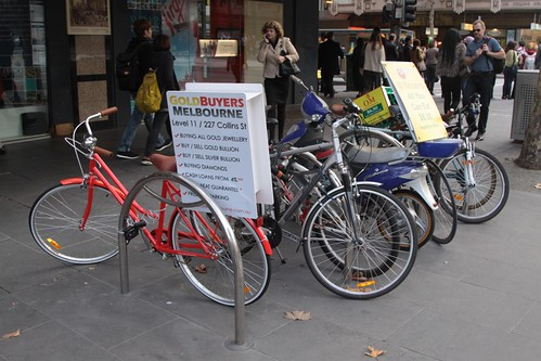 Seven parked bikes, three of them there for advertising purposes.