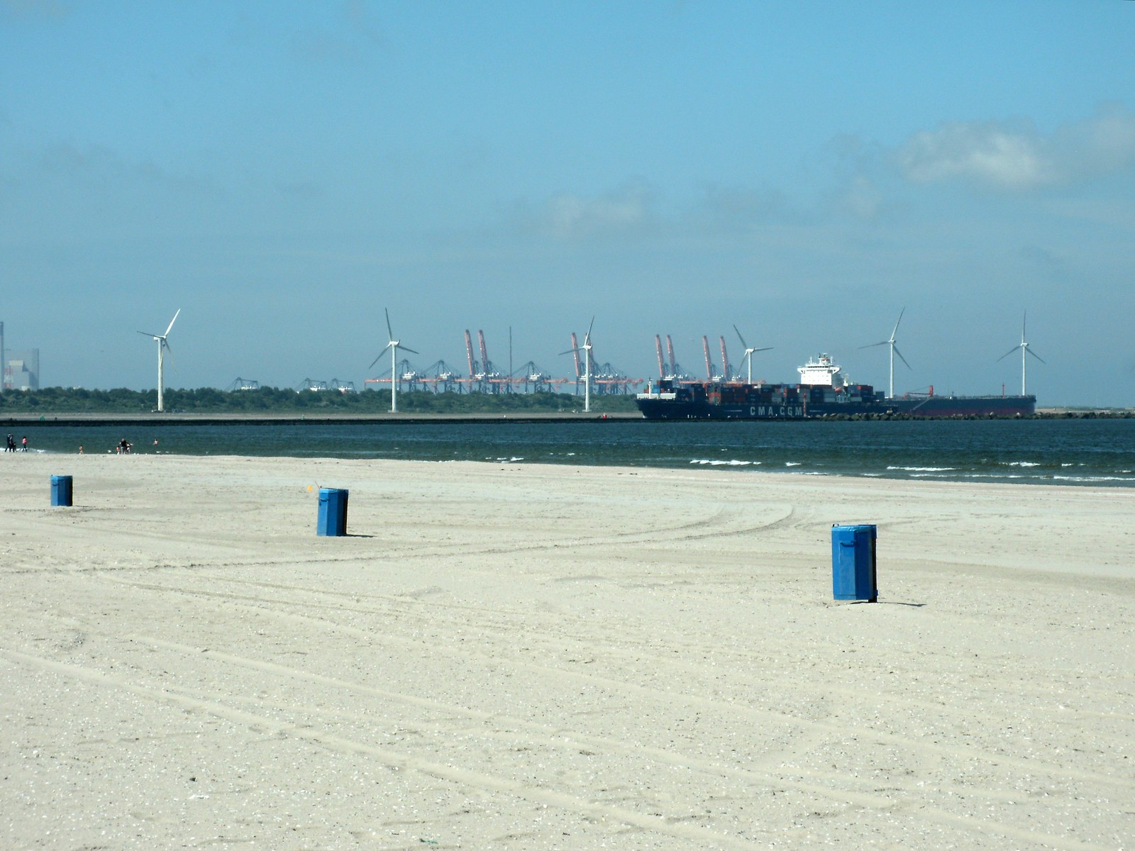 A large ship is approaching the harbor in the distance.