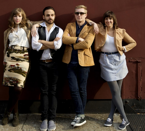 The four members of lake street dive lean on one another