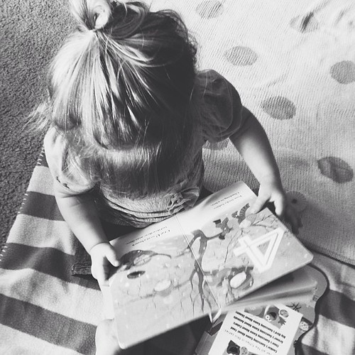 Legs crossed, messy bun, reading a few books on the floor. #eisleygirl