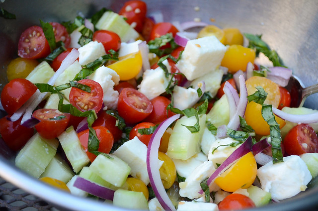 A mixture of vegetables and mozzarella in a bowl.