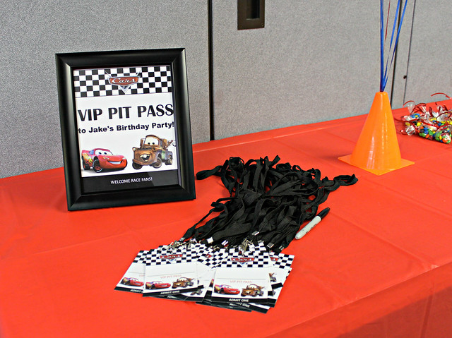 Welcome sign and pit pass name tags