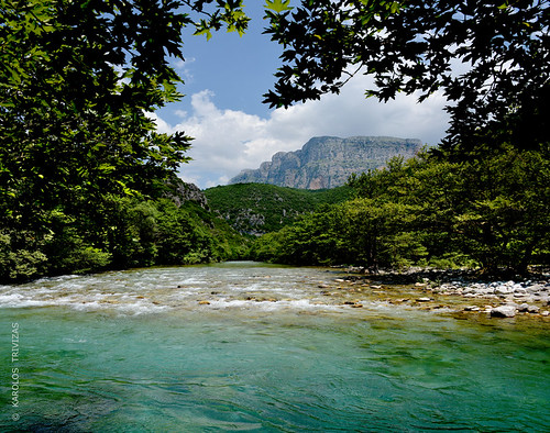 cliff mountain water clouds river rocks stones peak pebbles greece summit riverbank maples planetrees slopes epirus voidomatis aristi blinkagain